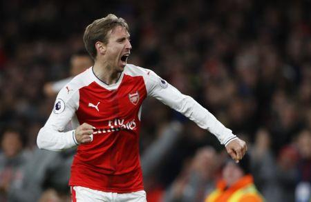 Britain Soccer Football - Arsenal v Leicester City - Premier League - Emirates Stadium - 26/4/17 Arsenal's Nacho Monreal celebrates after Leicester City's Robert Huth scores an own goal and the first goal for Arsenal Reuters / Stefan Wermuth