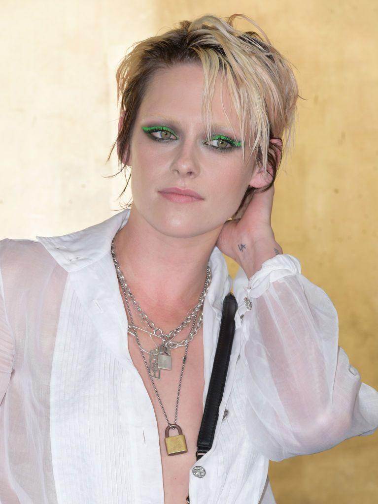 <p>Queen of alt-beauty, Kristen Stewart rocked up to the Chanel 2018/2019 Metiers d'Art Show in full experimental glory. Keeping the hair super undone with a wet-look pixie crop, her bleached eyebrows were almost outdone by her wicked green eyeliner and smokey-eye combo. Iconic. </p>