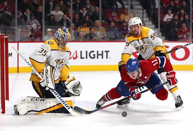 Brendan Gallagher (Montreal) chute devant Pekka Rinne (Nashville)./Photo prise le 11 février 2018/REUTERS/USA Today Sports