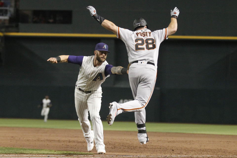 Arizona Diamondbacks first baseman Christian Walker tags out San Francisco Giants' Buster Posey to complete a double play during the sixth inning of a baseball game Thursday, Aug. 15, 2019, in Phoenix. (AP Photo/Darryl Webb)
