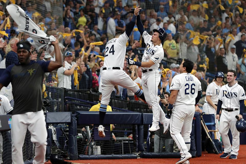 Willy Adames of the Tampa Bay Rays celebrates with teammate Avisail Garcia in ALDS Game 4. (Photo by Mike Carlson/MLB Photos via Getty Images)