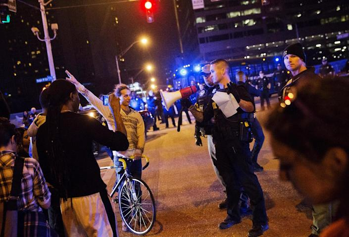 <p>Protesters are told to get out of the street by police as they march against the election of President-elect Donald Trump in Atlanta, Friday, Nov. 11, 2016. (AP Photo/David Goldman) </p>