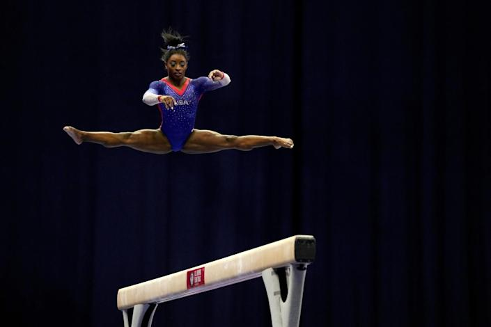 Simone Biles competes on the balance beam during the women's U.S. Olympic trials June 25, 2021.