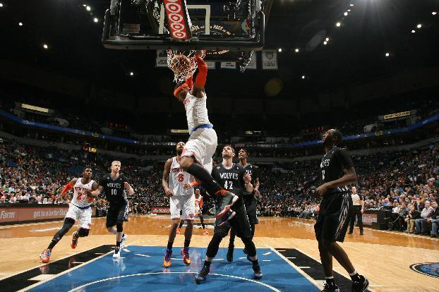 MINNEAPOLIS, MN - MARCH 5: Carmelo Anthony #7 of the New York Knicks dunks against the Minnesota Timberwolves on March 5, 2014 at Target Center in Minneapolis, Minnesota. (Photo by David Sherman/NBAE via Getty Images)
