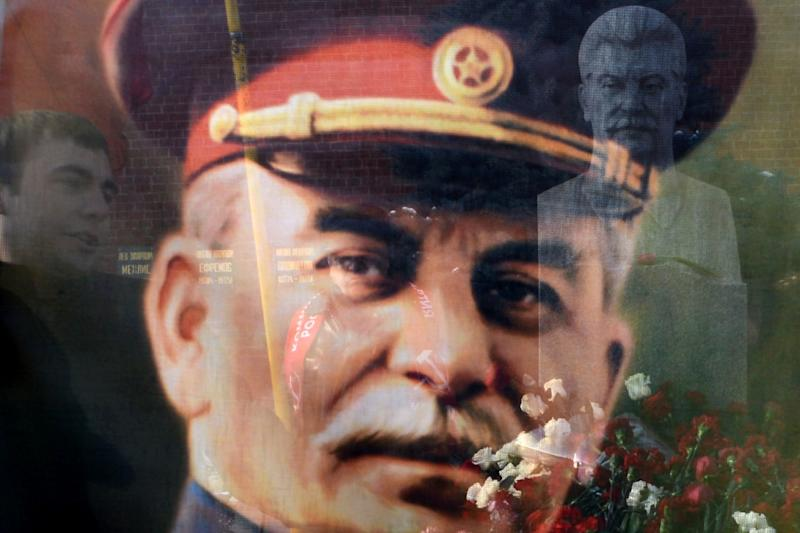 A bust of Joseph Stalin at his tomb (R) pictured through a transparent portrait of the Soviet dictator on Red Square in Moscow on March 5, 2013 (AFP Photo/Kirill Kudryavtsev)