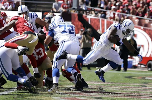 Indianapolis Colts running back Trent Richardson, right, scores on a one-yard touchdown run against the San Francisco 49ers in the first half of an NFL football game in San Francisco, Sunday, Sept. 22, 2013. (AP Photo/Ben Margot)