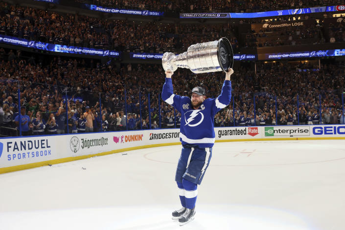 Tampa Bay Lightning's Steven Stamkos hoists the Stanley Cup after the team's 1-0 victory against the Montreal Canadiens in Game 5 of the NHL hockey Stanley Cup Finals, Wednesday, July 7, 2021, in Tampa, Fla. (Bruce Bennett/Pool Photo via AP)