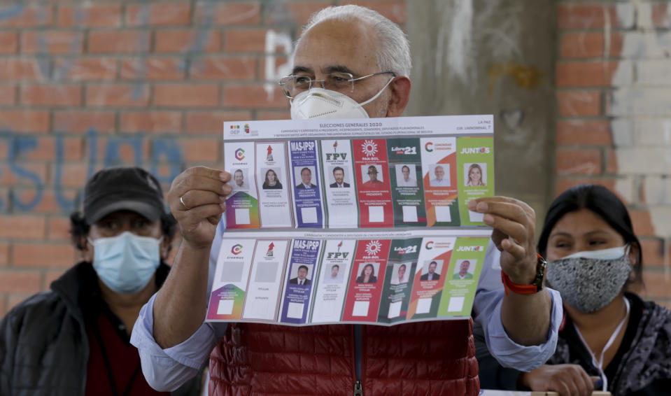 Carlos Mesa, who is running for president with the Citizen Community party, shows the ballot during general elections in La Paz, Bolivia, Sunday, Oct. 18, 2020. (AP Photo/Martin Mejia)