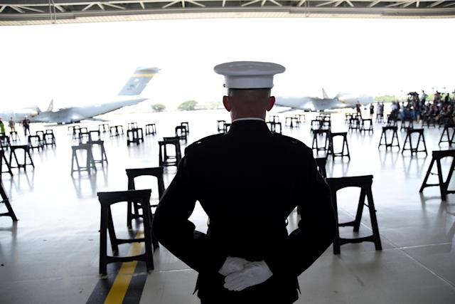 <p>A U.S. Marine stands at attention as caskets containing the remains of American servicemen from the Korean War handed over by North Korea arrive at Joint Base Pearl Harbor-Hickam in Honolulu, Hawaii, Aug. 1, 2018. (Photo: Hugh Gentry/Reuters) </p>