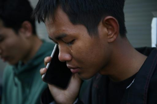 A tear falls from the eye of Weerapat Ketsunthia as he talks on the phone and mourns his friend Atiwat Promsuk, who was killed in a mass shooting at the Terminal 21 shopping mall in Nakhon Ratchasima, Thailand