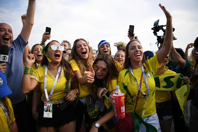 <p>Brazil fans enjoy the pre match atmosphere during the 2018 FIFA World Cup Russia Round of 16 match between Brazil and Mexico at Samara Arena on July 2, 2018 in Samara, Russia. (Photo by Matthias Hangst/Getty Images) </p>