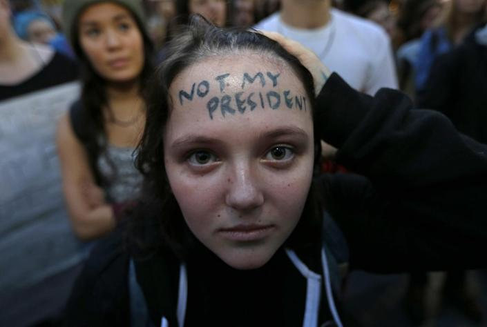 """<p>Clair Sheehan has the words """"Not My President"""" written on her forehead as she takes part in a protest against the election of President-elect Donald Trump, Wednesday, Nov. 9, 2016, in downtown Seattle. (AP Photo/Ted S. Warren) </p>"""