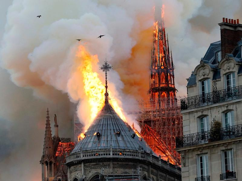Notre Dame cathedral fire: Historic landmark's roof and spire collapse in centre of Paris