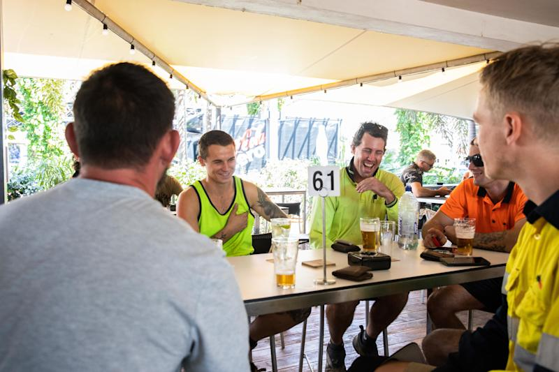 Friends drinking beer at the Cavenaugh Hotel in Darwin after coronavirus restrictions eased. Source: AAP