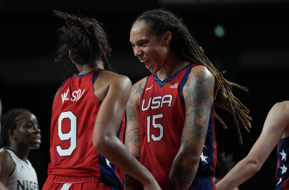 United States' Brittney Griner (15), right, celebrates score by teammate A'Ja Wilson (9) during women's basketball preliminary round game at the 2020 Summer Olympics, Tuesday, July 27, 2021, in Saitama, Japan. (AP Photo/Eric Gay)