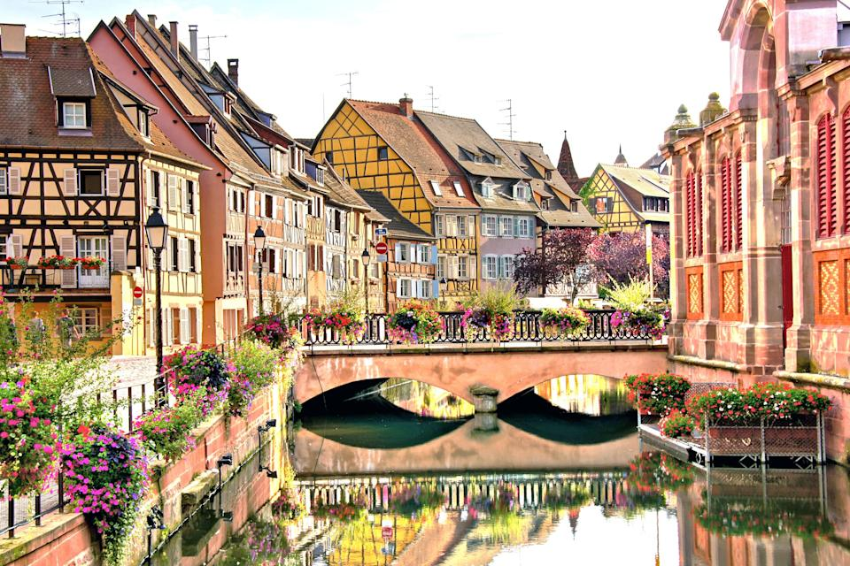 """<p><strong>Population:</strong> 70,284</p> <p>Picturesque Colmar has a neighborhood known as """"Little <a href=""""https://www.cntraveler.com/story/the-locals-guide-to-venice?mbid=synd_yahoo_rss"""" rel=""""nofollow noopener"""" target=""""_blank"""" data-ylk=""""slk:Venice"""" class=""""link rapid-noclick-resp"""">Venice</a>,"""" giving Annecy a run for its money on the Venice comparisons, with small canals that cut elegant lines past candy-colored houses. Locals aren't the only ones inspired by Colmar's beauty, though: Some people believe the town was the model for Belle's village in Disney's <em>Beauty and the Beast</em>.</p>"""