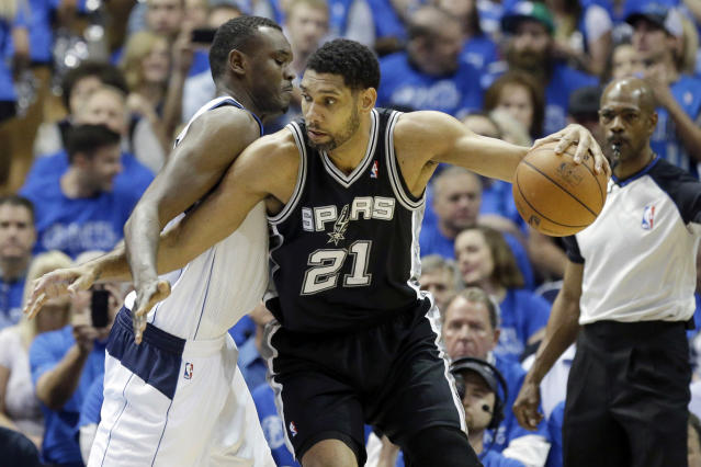 San Antonio Spurs forward Tim Duncan (21) is defended by Dallas Mavericks center Samuel Dalembert (1) during the first half of Game 3 of an NBA basketball first-round playoff series in Dallas, Saturday, April 26, 2014. (AP Photo/LM Otero)