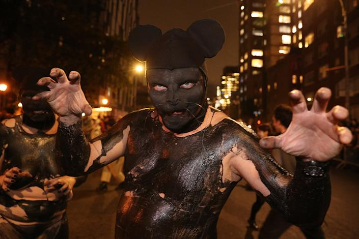 A reveler wearing mouse ears marches in the annual Village Halloween Parade in New York City. (Photo: Gordon Donovan/Yahoo News)