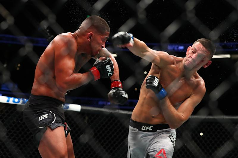 ANAHEIM, CALIFORNIA - AUGUST 17: Nate Diaz throws a punch at Anthony Pettis in the second round during their Welterweight Bout at UFC 241 at Honda Center on August 17, 2019 in Anaheim, California. (Photo by Joe Scarnici/Getty Images)