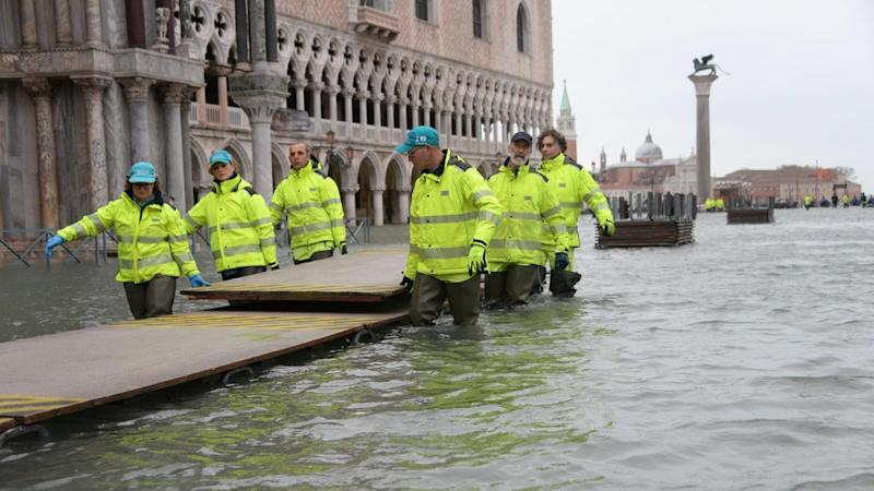 St Mark's Square was submerged and closed to tourists as the high tide in Venice peaked at 154cm