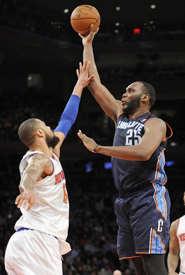 Charlotte Bobcats' Al Jefferson, right, attempts to shoot over New York Knicks' Tyson Chandler during the third quarter of an NBA basketball game, Friday, Jan. 24, 2014, at Madison Square Garden in New York. Jefferon led the Bobcats with 25 points but the Knicks won 125-96. (AP Photo/Bill Kostroun)