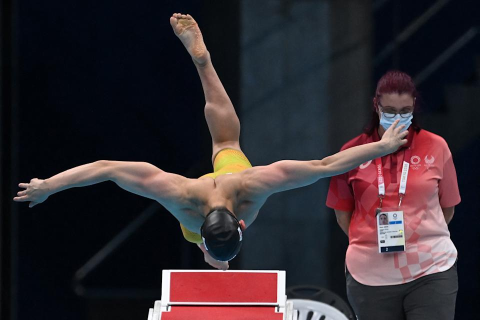 <p>South Korea's Moon Seung-woo dives to start in a heat for the men's 100m butterfly swimming event during the Tokyo 2020 Olympic Games at the Tokyo Aquatics Centre in Tokyo on July 29, 2021. (Photo by Jonathan NACKSTRAND / AFP) (Photo by JONATHAN NACKSTRAND/AFP via Getty Images)</p>
