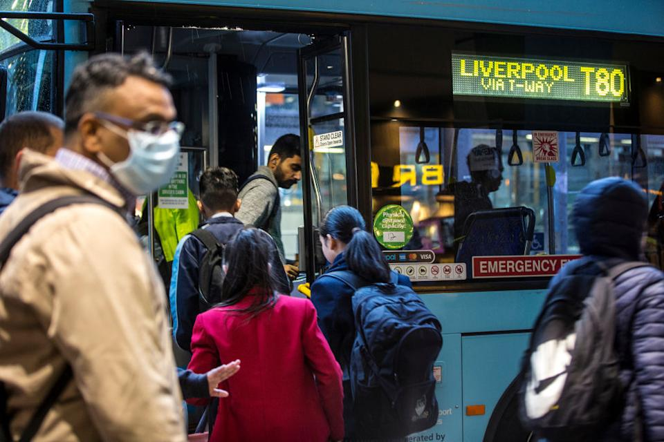 Commuters get on a Sydney bus. Scientists believe enclosed spaces like on public transport are more dangerous than first thought.