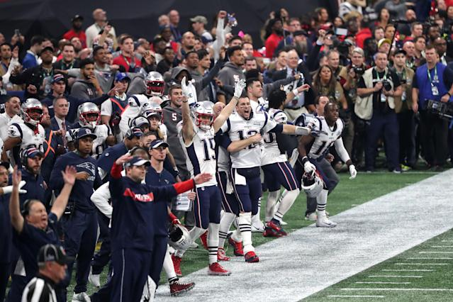 <p>Tom Brady #12 and Chris Hogan #15 of the New England Patriots celebrate a missed field goal late in the fourth quarter against the Los Angeles Ramsduring Super Bowl LIII at Mercedes-Benz Stadium on February 03, 2019 in Atlanta, Georgia. (Photo by Streeter Lecka/Getty Images) </p>