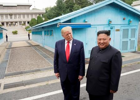 FILE PHOTO: FILE PHOTO: Trump meets with North Korean leader Kim Jong Un at the DMZ on the border of North and South Korea