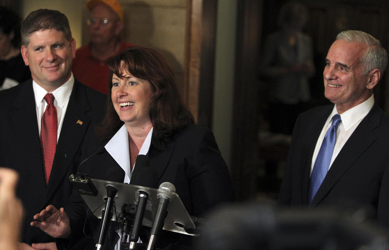 Bi-partisan smiles were visible during a news conference outside Gov. Mark Dayton's office as GOP leaders Sen. Amy Koch, middle,  and Speaker of the House Kurt Zellers, left, joined Dayton, right, in announcing a special legislative session and possibility of getting a budget passed Tuesday, July 19, 2011, in St. Paul, Minn. (AP Photo/Star Tribune, David Joles)  MANDATORY CREDIT; ST. PAUL PIONEER PRESS OUT; MAGS OUT; TWIN CITIES TV OUT