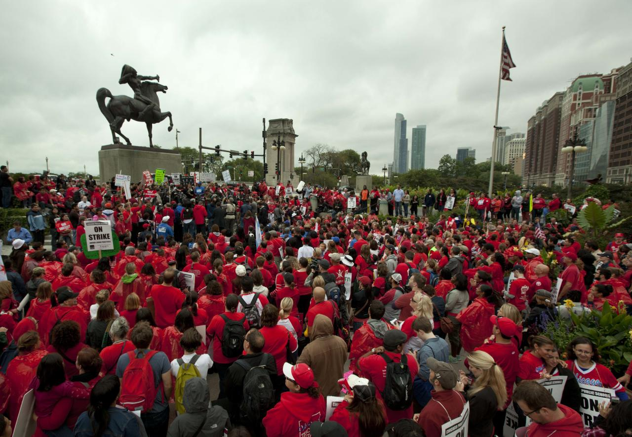 A large crowd of public school teachers rally at Chicago's Congress Plaza to protest against billionaire Hyatt Hotel mogul Penny Pritzker, who is also a member of the Chicago Board of Education on Thursday, Sept. 13, 2012. Protesters said that $5.2 million in Tax Increment Financing (TIF) funds being used to build a new Hyatt hotel in Hyde Park would be better spent on meeting basic student needs. (AP Photo/Sitthixay Ditthavong)