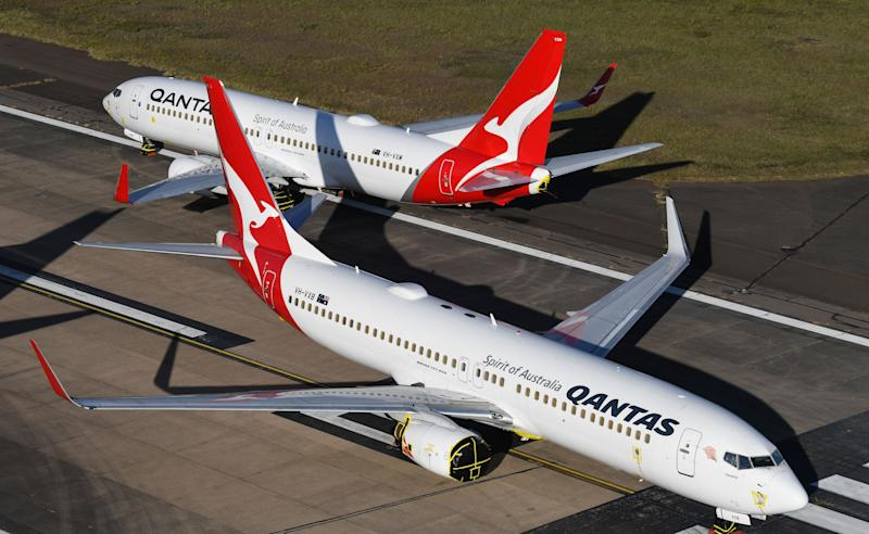 Qantas 737-800 aircraft parked on the east-west runway at Sydney Airport. (Photo: James D. Morgan via Getty Images)