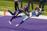Dallas Cowboys wide receiver CeeDee Lamb (88) catches a 4-yard touchdown pass ahead of Minnesota Vikings cornerback Jeff Gladney, left, during the first half of an NFL football game, Sunday, Nov. 22, 2020, in Minneapolis. (AP Photo/Jim Mone)