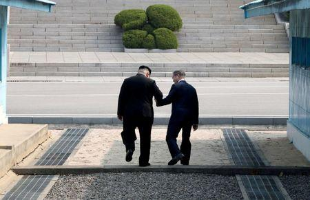 South Korean President Moon Jae-in and North Korean leader Kim Jong Un meet in the truce village of Panmunjom