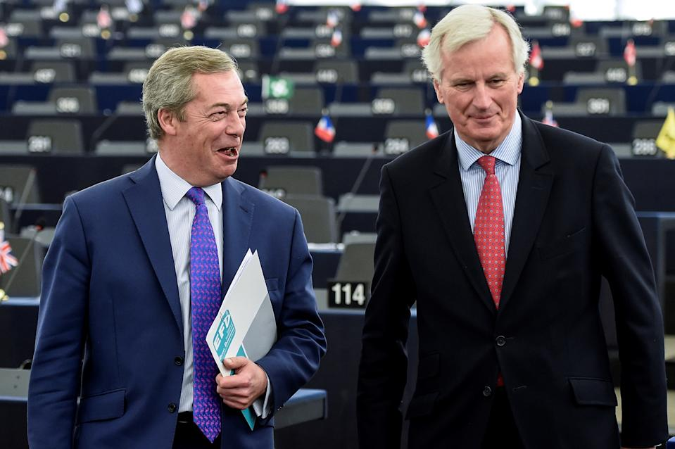 "European commission member in charge of Brexit negotiations with Britain, French Michel Barnier (R) speaks with Member of the European Parliament and former leader of the anti-EU UK Independence Party (UKIP) Nigel Farage at the European Parliament in Strasbourg, eastern France, on April 5, 2017.   The European Parliament will on April 5 lay down its ""red lines"" for negotiations over a Brexit deal, on which the assembly will have the final say in two years' time. / AFP PHOTO / Sebastien Bozon        (Photo credit should read SEBASTIEN BOZON/AFP via Getty Images)"