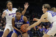 Seton Hall guard/forward Desiree Elmore (25) drives against DePaul guard Deja Church, left, and guard Kelly Campbell during the second half of an NCAA college basketball game in the Big East women's tournament semifinals, Sunday, March 8, 2020, in Chicago. (AP Photo/Nam Y. Huh)