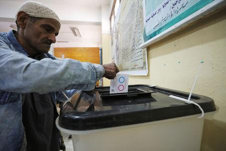 A man casts his vote during the referendum on draft constitutional amendments, at a polling station in Cairo, Egypt April 20, 2019. REUTERS/Mohamed Abd El Ghany