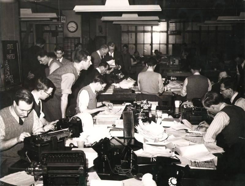 File photo from the Reuters archive shows journalists in the Reuters Newsroom during the 1950 British General Election