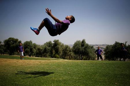 Palestinian youth play in a park in Jerusalem May 11, 2017. Picture taken May 11, 2017. REUTERS/Amir Cohen