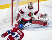 Ottawa Senators goaltender Joey Daccord (34) makes a save on Montreal Canadiens right wing Tyler Toffoli (73) during the first period of an NHL hockey game Tuesday, March 2, 2021, in Montreal. (Ryan Remiorz/The Canadian Press via AP)