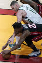 Milwaukee Bucks center Brook Lopez (11) and Miami Heat forward Jimmy Butler (22) go for control of the ball during the second half of Game 3 of an NBA basketball first-round playoff series Thursday, May 27, 2021, in Miami. (AP Photo/Marta Lavandier)