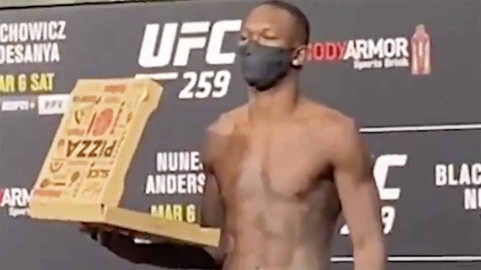 Israel Adesanya is feeling so confident ahead of UFC 259 that he brought a pizza to his weigh-in. Picture: ESPN MMA/Twitter