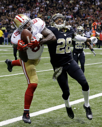 San Francisco 49ers wide receiver Anquan Boldin (81) pulls in a touchdown reception in front of New Orleans Saints cornerback Keenan Lewis (28) in the first half of an NFL football game in New Orleans, Sunday, Nov. 9, 2014. (AP Photo/Bill Haber)