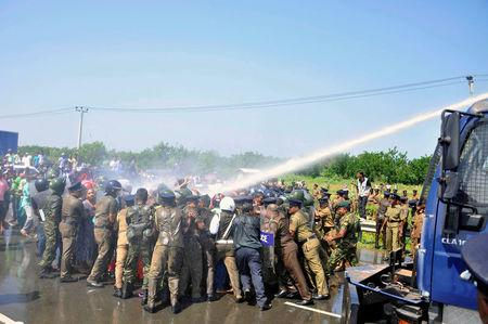 FILE PHOTO: Police used tear gas at demonstrators during a protest against the launching of a $5 billion Chinese investment zone by China Merchants Port Holdings Company, in Mirijjawila, Sri Lanka January 7, 2017. REUTERS/Stringer/File Photo