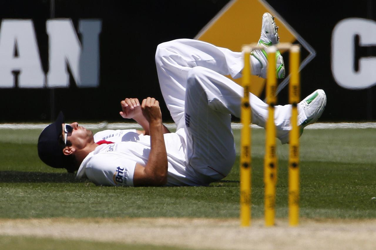 England's captain Alastair Cook reacts after dropping a catch played by Australia's Chris Rogers during the fourth day of the fourth Ashes cricket test at the Melbourne cricket ground December 29, 2013. REUTERS/David Gray (AUSTRALIA - Tags: SPORT CRICKET)