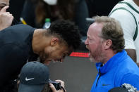 Milwaukee Bucks coach Mike Budenholzer and inured forward Giannis Antetokounmpo celebrate after the Bucks defeated the Atlanta Hawks in Game 6 of the Eastern Conference finals in the NBA basketball playoffs, advancing to the NBA Finals, Saturday, July 3, 2021, in Atlanta. (AP Photo/John Bazemore)