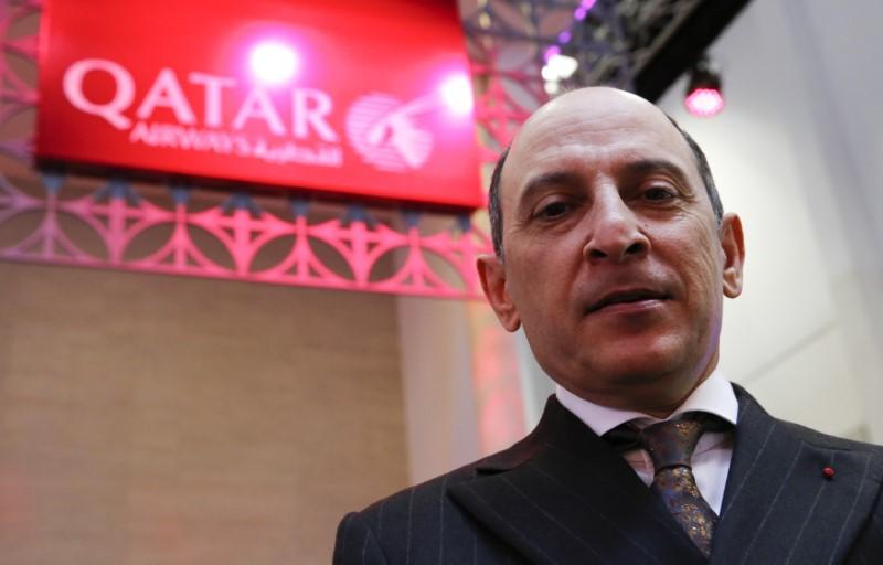 Qatar Airways Chief Executive Akbar Al Baker tours the stand of company at the International Tourism Trade Fair in Berlin
