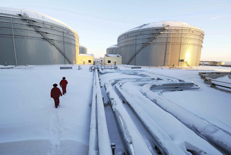 In this photo released by China's Xinhua News Agency, workers inspect the pipelines and oil storage tanks of China and Russia crude oil pipeline in Mohe, northeast China's Heilongjiang Province, Saturday, Jan. 1, 2011. The nearly 1, 000-kilometer (625-miles) -long China and Russia crude oil pipeline starts its full operation here Saturday and it will carry 15 million tons of crude oil annually from Russian oilfields into China in the next 20 years, according to Xinhua. The pipeline, a joint project conducted by PetroChina, China's largest oil and gas producer, and Rosnef, Russia's largest oil company, is part of Russia's 4, 000-kilometer (2,500-mile) East Siberia to Pacific Ocean Pipeline Shipment project, Xinhua also said. (AP Photo/Xinhua, Wang Jianwei) NO SALES