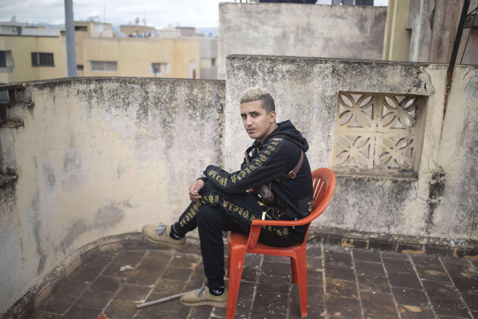 In this Thursday, Nov. 21, 2019 photo, Moroccan rapper Tarik El Tazi, known as Tflow, poses for a portrait in Fes, Morocco. (AP Photo/Mosa'ab Elshamy)