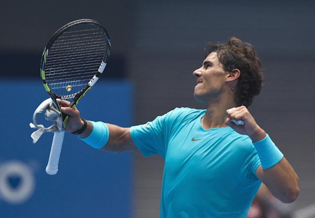 Rafael Nadal of Spain celebrates after defeating Fabio Fognini of Italy during the quarterfinal match in China Open tennis tournament at the National Tennis Stadium in Beijing, China Friday, Oct. 4, 2013. (AP Photo/Andy Wong)